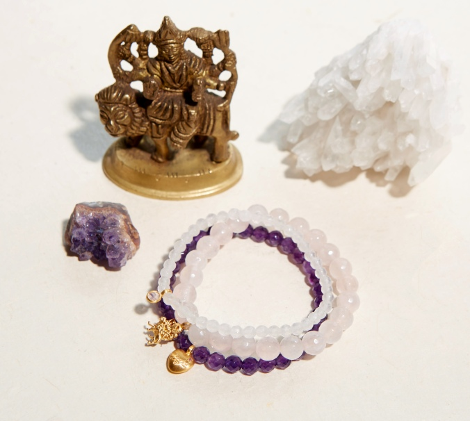 durga statue and bracelets